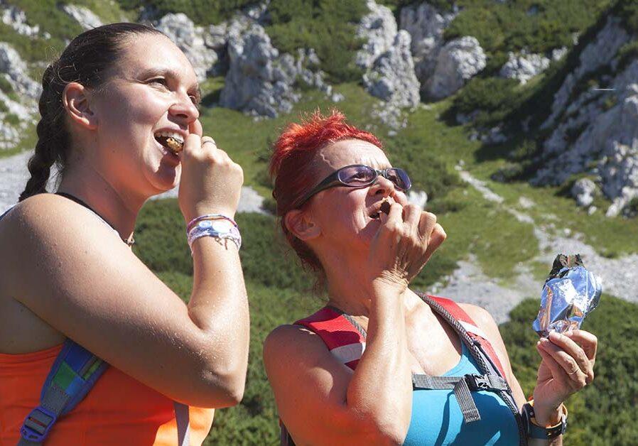 360-mr-women-eating-granola-bars-outdoor-adventure-travel